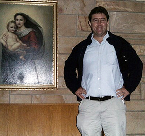 Steve next to painting of Madonna and Child